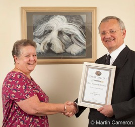 Christopher Hodgson presents Chris Jones with her People's Choice Award for 'Bad Hair Day' (pictured).