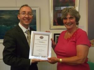 Rob Davis presents Lincolnshire Pride Award to Wendy Else